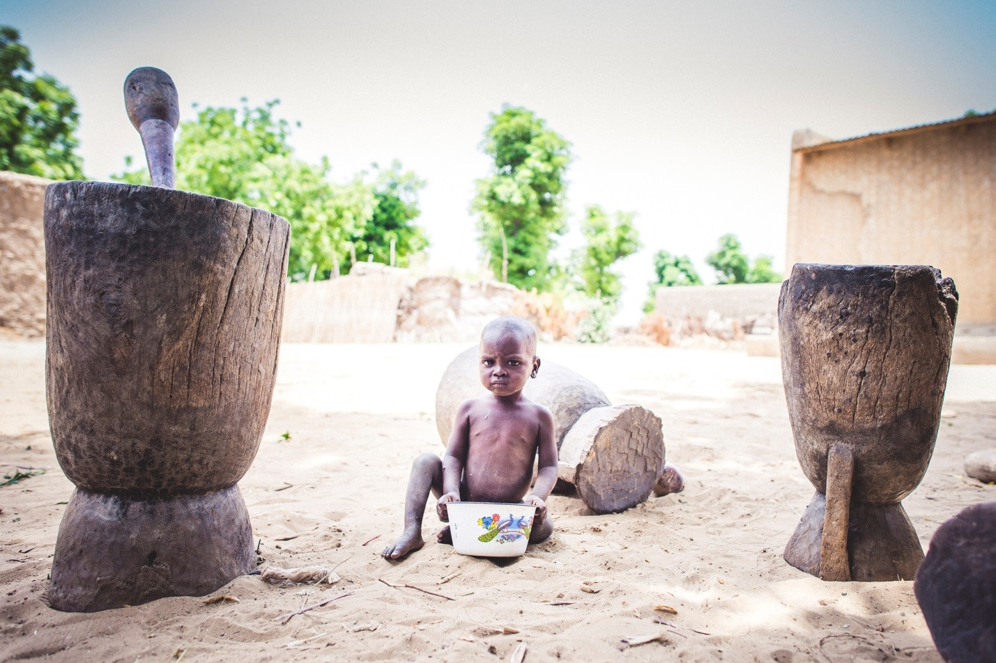 calabash_mortar_and_pestle_with_child