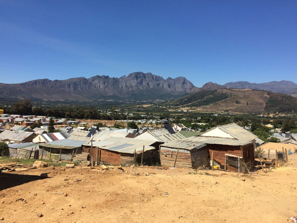 Formal social housing sits adjacent to the informal settlement in Langrug. Copyright: Lauren Hermanus.