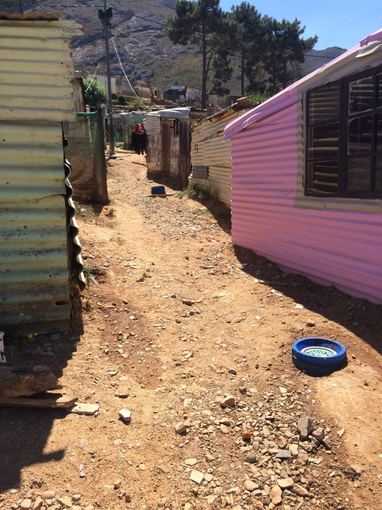 A section of Langrug with new grey-water disposal points to keep the road clean and dry shows the dramatic difference in efficacy compared with the old system. Copyright: Lauren Hermanus.