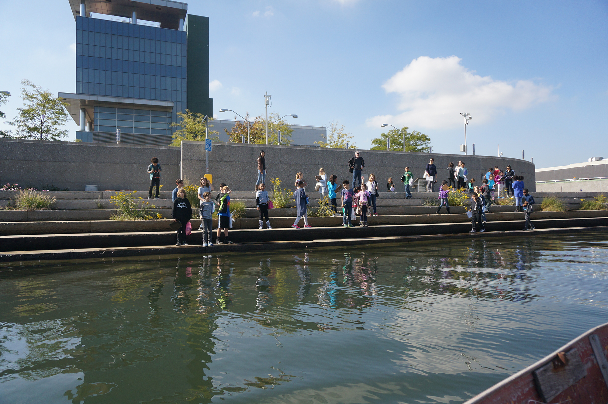 Students take a walk along Newtown Creek on the nature path. Across the water lies an industrial landscape and the city, shown in the header image of the story. Image courtesy of the Newtown Creek Alliance.