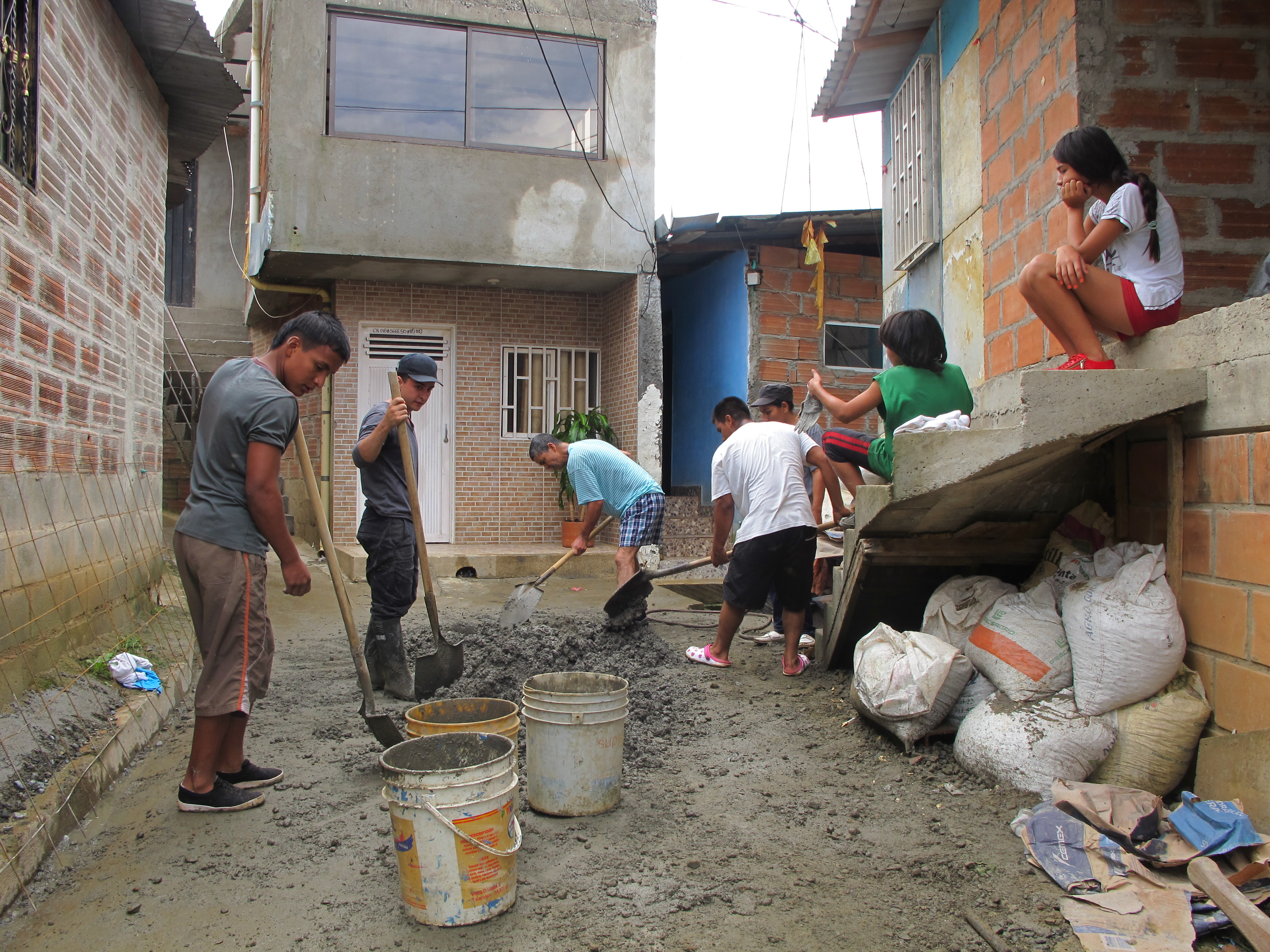 Community members putting drainage mitigation works in place in Medellín.