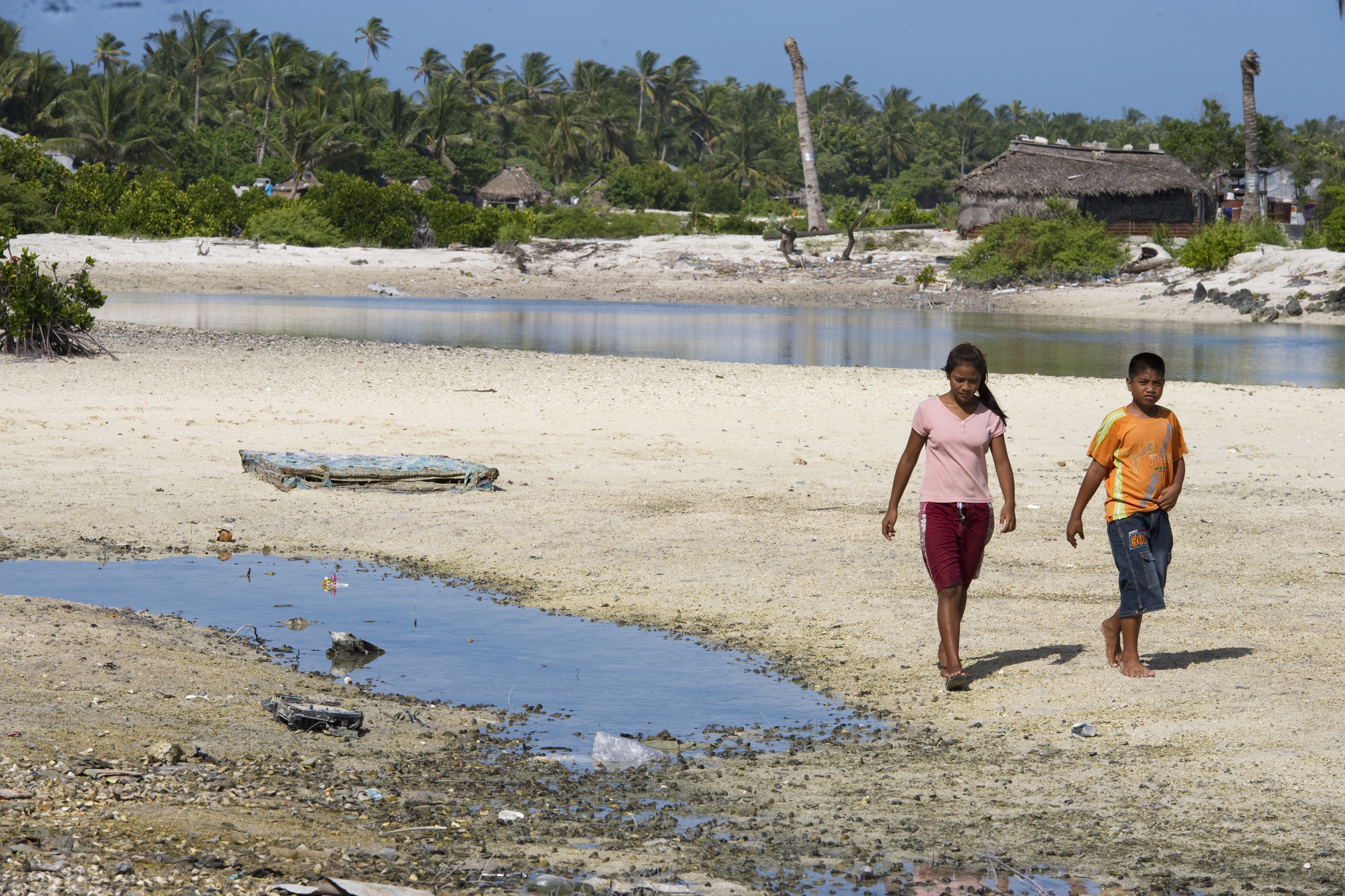 Locals in Tebikenikora, a village in the Pacific island nation of Kiribati. When tide is high the sea water very easily overflows the surrounding land making it impossible for people to use this land. Photo credit: UN Photo/Eskinder Debebe/Flickr.