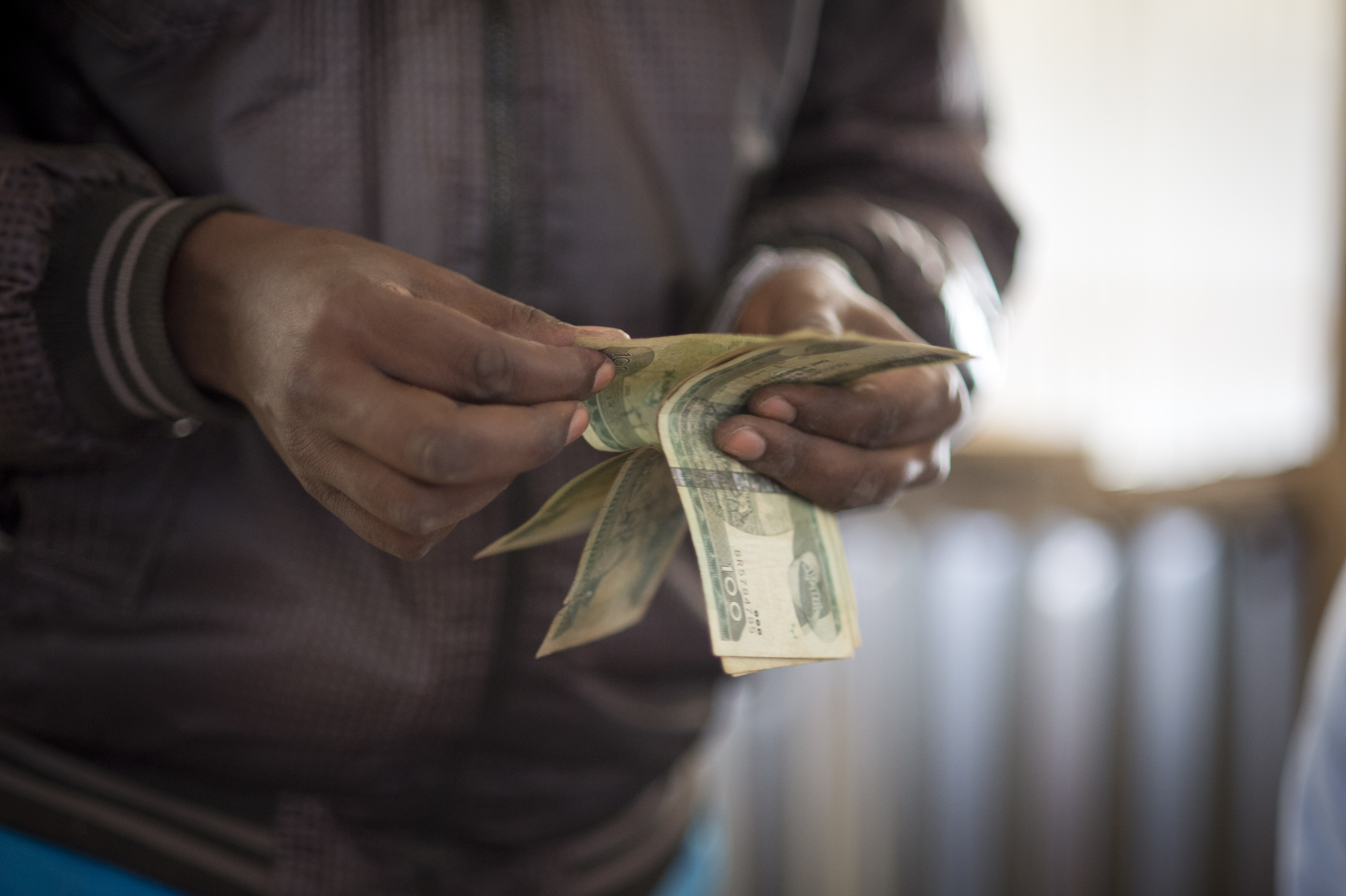 Remittances can be a lifeline for poor people, but many transfers are subject to high fees. Photo credit: WFP/Giulio d'Adamo/Flickr.