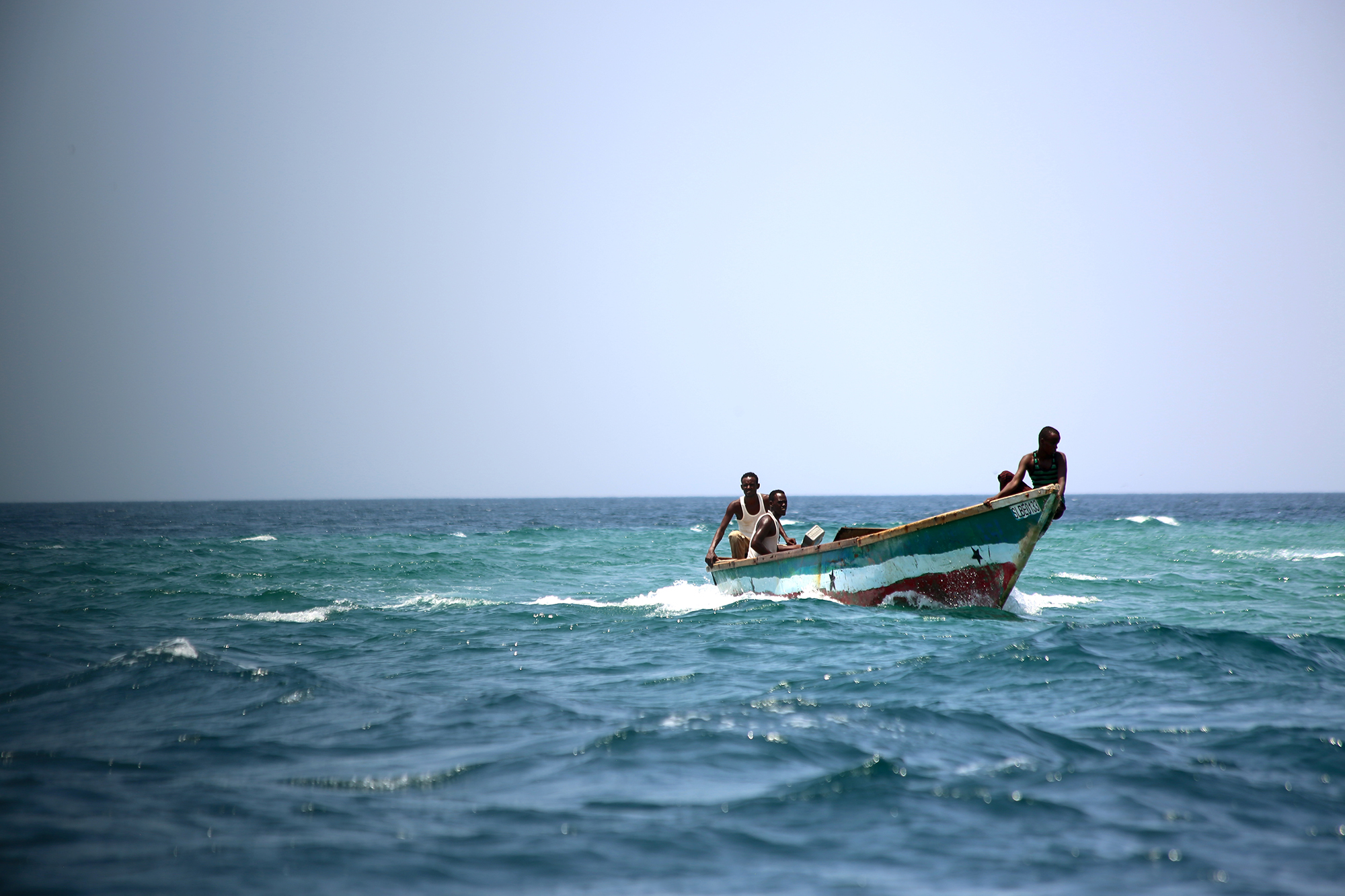 Fishers in the Gulf of Aden returning home with their catch. Copyright Jean-Pierre Larroque, One Earth Future Foundation.
