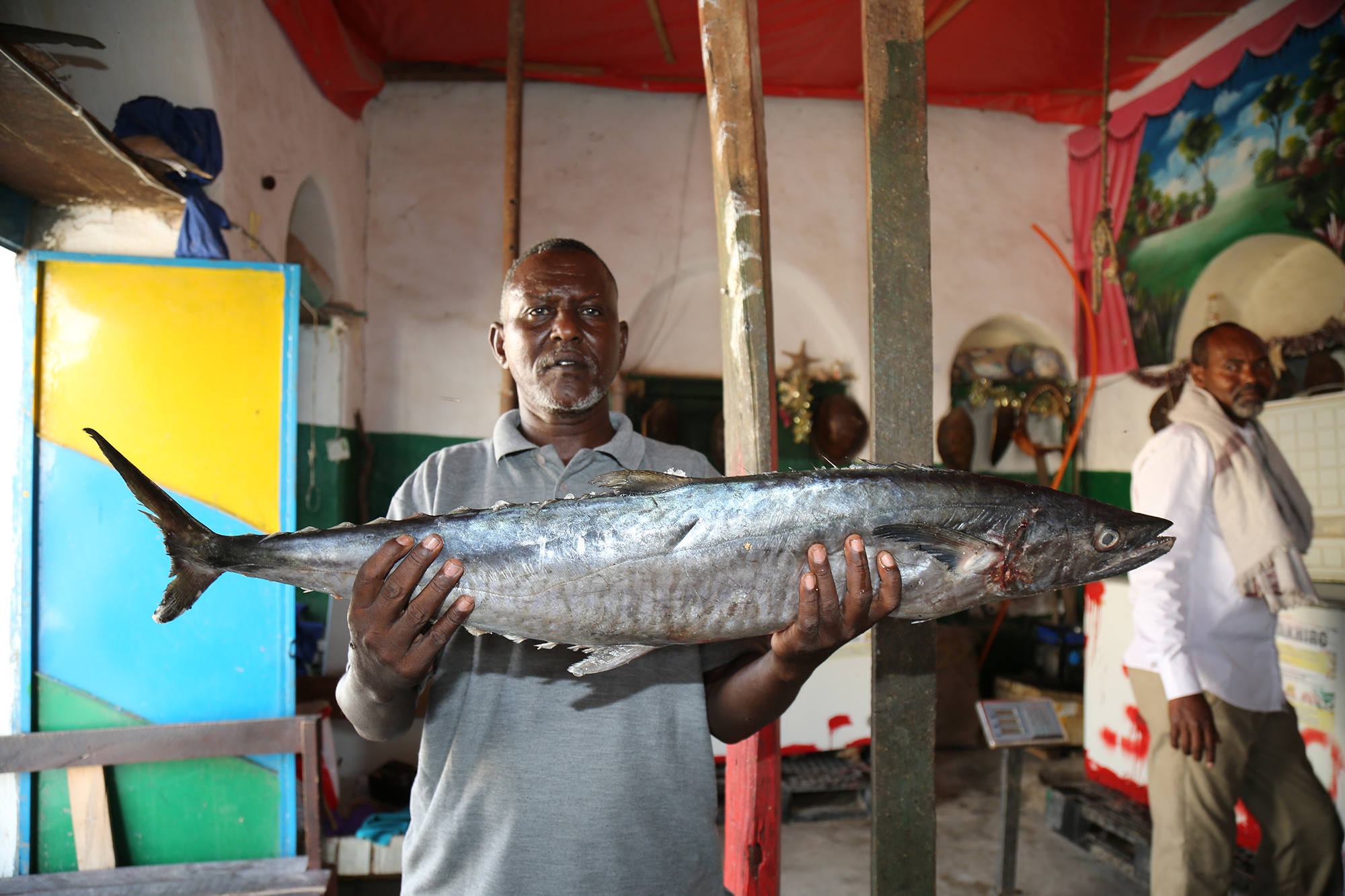 Jama Ahmed Mohamed holds a Jack at Alla Aamin Fishing Company in Berbera Somaliland_ Copyright Jean-Pierre LarroqueOne Earth Future Foundation