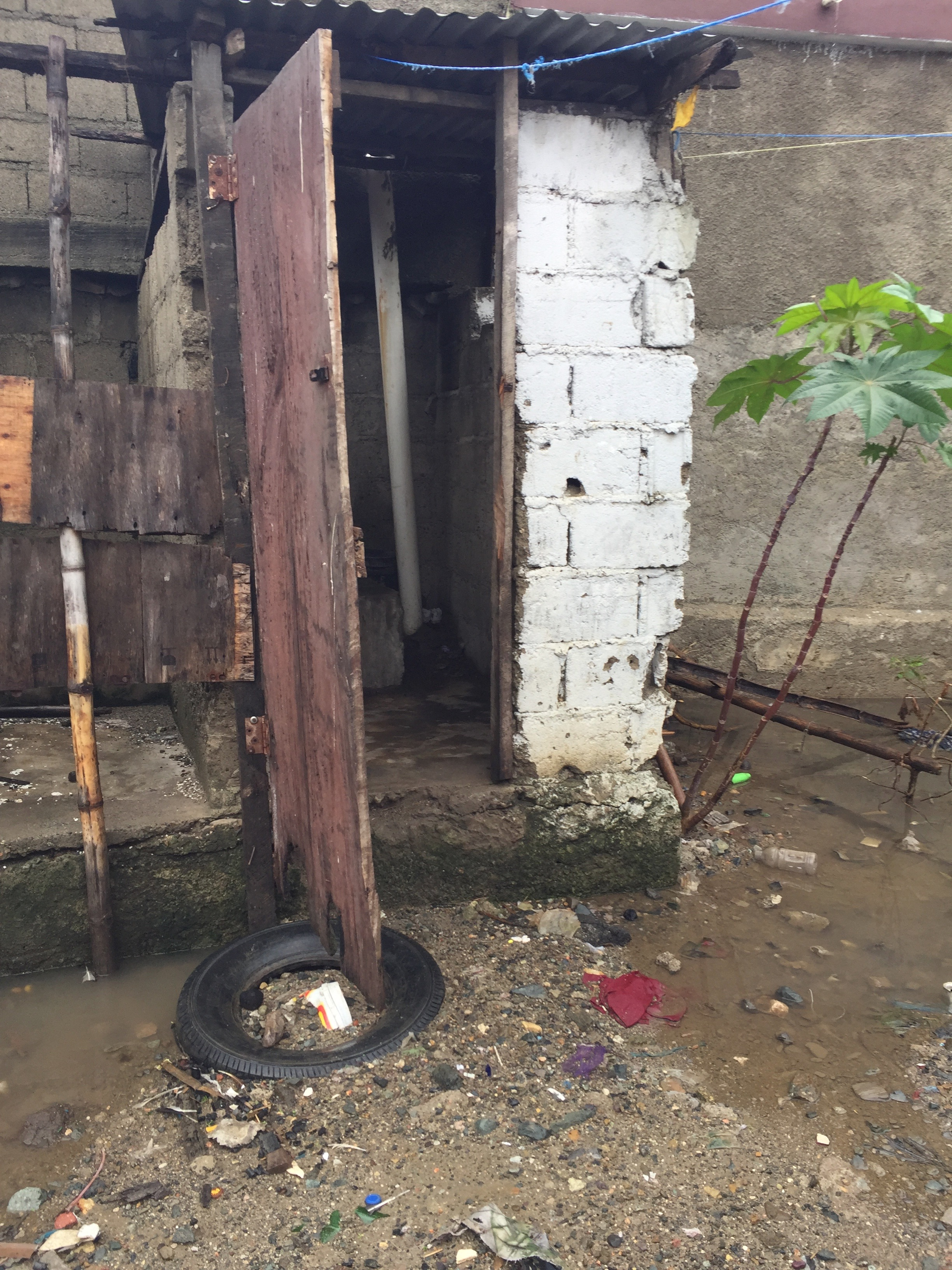 A pit latrine in regular use in Cap-Haitien by Chelsea Wald (Creative Commons)